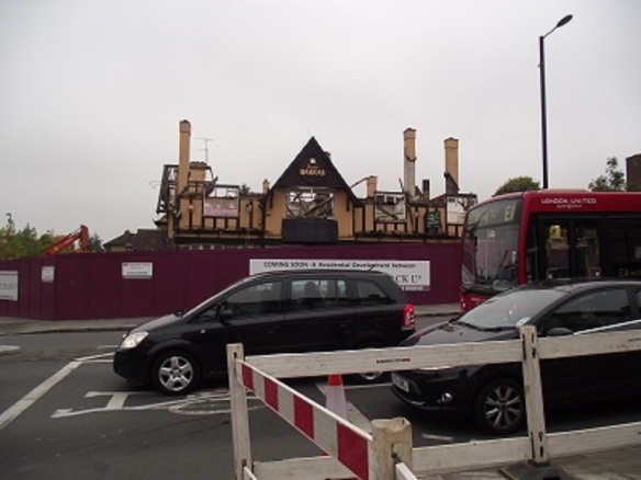 Demolition of Red Lion pub,  junction of Greenford Broadway and Greenford Road, London Borough of Ealing (photo Albertina McNeill 2014)
